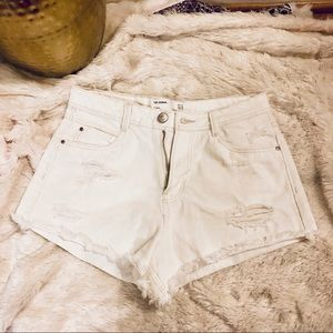 Zara Trafaluc White Denim Ripped Shorts